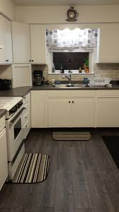 Laminate Flooring Kitchens The White And Grey Kitchen Trend Continues Kronoswiss Tokyo Oak V