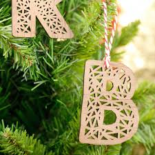 personalised real walnut wooden letter xmas decoration by denvers