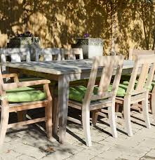 frontgate melbourne teak dining table and eight teak chairs ebth