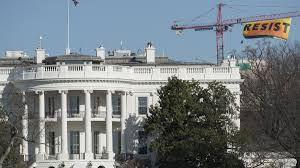 protesters scale crane located near white house unfurl u0027resist