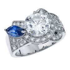 platinum art deco custom made diamond ring with marquise blue