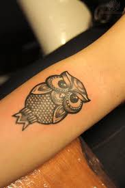 tiny owl bird tattoo on arm photos pictures and sketches