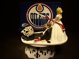 wedding cake edmonton hockey sports team edmonton oilers and groom wedding