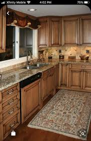 brown kitchen cabinets with backsplash maple cabinets ideas on foter