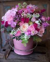Floral Arrangement Floral Arrangement With Pink And Purple Flowers In Pink Pail Or