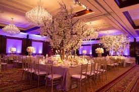 white gold and purple wedding white lavender ballroom wedding with cherry blossom