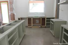 kitchen progress dark green cabinets a rustic wood countertop