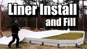 how to install a backyard rink liner and fill it