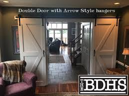 is black hardware in style door arrow style bi parting barn door hardware kit black powdercoat free shipping