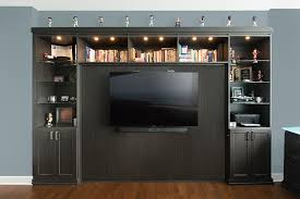 horizontal murphy wall bed with tv mounted to bed panel