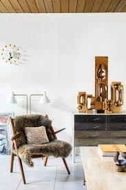 modern living room with sandstone tile floors by lukas machnik