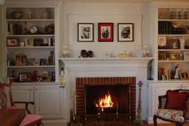 fireplace with built in shelves bookcases around design stone wood