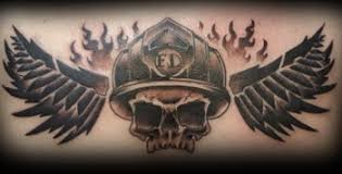 skull firefighter with wings across the chest tattoos