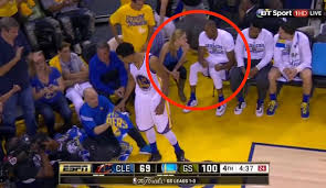 who is the blonde in the game of heroes commercial andre iguodala was chatting up a blonde chick on the bench during