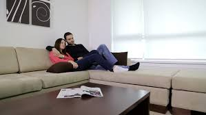 Young Couple Room Tracking Shot Of Couple On Couch In Living Room Stock Footage