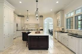 white kitchen with island kitchen ceramic tile floor white kitchen cabinet black wooden