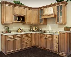 small l shaped kitchen with maple cabinets with white countertop