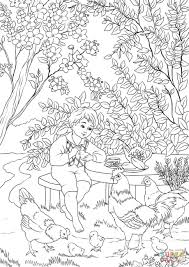 a boy enjoying a warm spring day in the garden with chicken