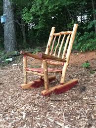 outdoor black resin wicker rocker upholstered swivel rocking