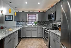 light gray kitchen cabinets throwing shade on the gray kitchen design in a way