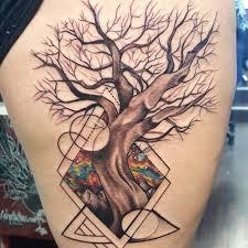 wonderful abstract tree design on thigh tattoomega