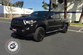 norwalk toyota serving los angeles toyota tundra wrapped in 3m satin black wrap wrap bullys