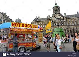 dogs on dam square amsterdam netherlands queens palace stock