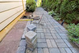 stone pavers and tiles for side yard patio hardscape with garden