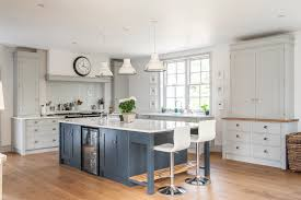 take five stunning kitchen islands property price advice this bespoke kitchen rencraft hand painted farrow ball pavilion grey the cabinetry and railings island unit prices start from