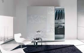 large white wooden sliding closet doors with frozen glass accent