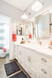 best ideas about shared bathroom pinterest kid kid bathroom complete with ample lighting and crisp clean design details including redland sconces bingham