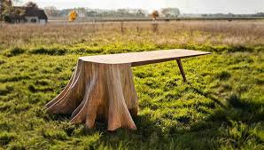 artist designs stunning table with tree stump for leg