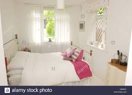renovated flat interiimage of bedroom iron bed pink cushions pink