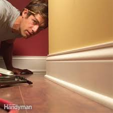 how much does it cost to install base cabinets how to install baseboard trim even on crooked walls diy