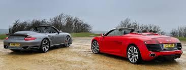 vs porsche 911 turbo car clash audi r8 spyder vs porsche 911 turbo cabriolet car