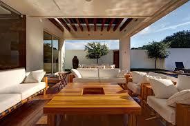 outdoor livingroom outdoor living room pergola wood varnished table white glass fruit