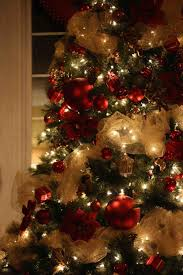 white tree decorations and gold cheminee website