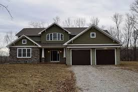the valmead park plan 1153 craftsman exterior blue siding craftsman style home with wood posts and front door