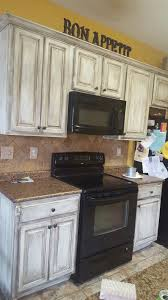 diy painted rustic kitchen cabinets 2 day distressed white chalk painted and glazed kitchen