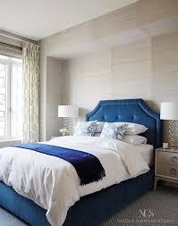 blue velvet headboard in tufted bed with gray nightstands