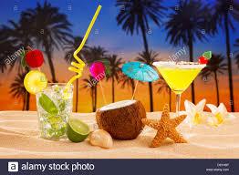 beach cocktail sunset on palm tree sand mojito margarita coconut