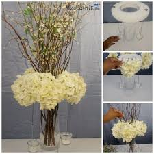 diy budget friendly blooming branches wedding centerpiece
