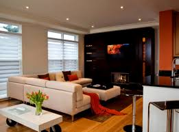 living room with tv above fireplace decorating ideas front door