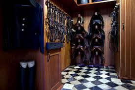 beautiful tack room dark rich wood in combination with black and