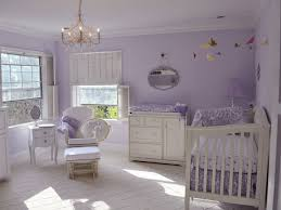 a classically styled white crib pops against lavender walls