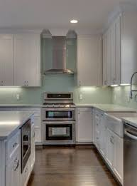 green glass backsplashes for kitchens sea green glass backsplash stainless steel appliances