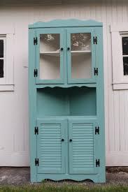 beautiful aqua blue polished corner cabinet with double glass door
