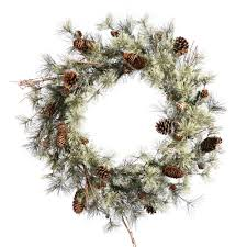 large outdoor wreath with lights togeteher