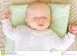 cute newborn baby sleeping in bed stock images image 28842984