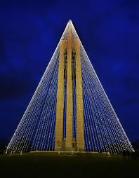 christmas lights net style carillon bell tower with christmas lights at night vertical hdr